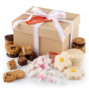 Chocolate chip cookies hand-frosted flower cookies brownie bites and candy in a gift box